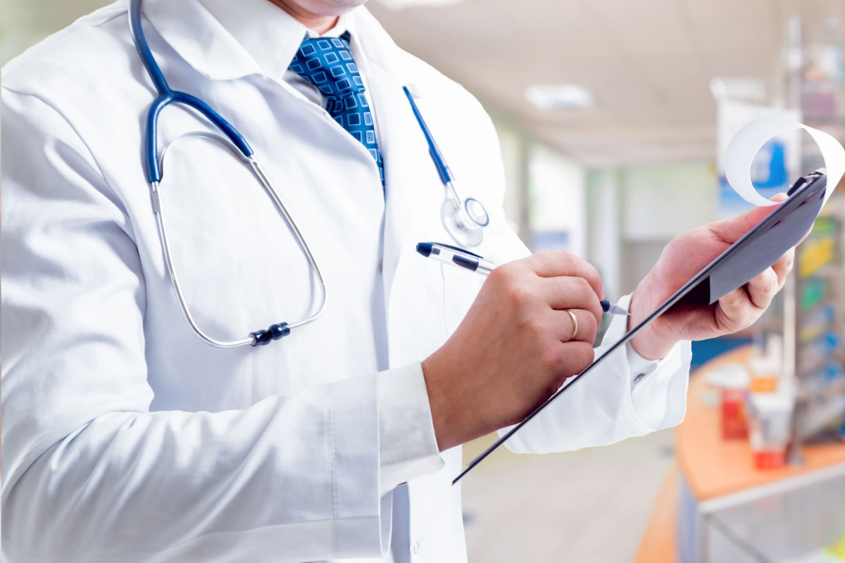 Doctor checking prescriptions on a clipboard